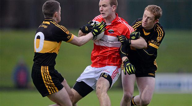 Darragh O'Sullivan, Dingle, in action against Colm Cooper, right, and Kieran O'Leary, Dr. Crokes. Photo: Sportsfile