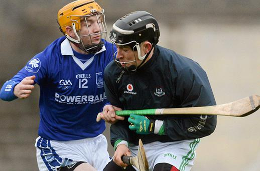 Kilmallock's Barry Hennessy holds off the challenge of Thurles Sarsfields' Lar Corbett. Photo: Sportsfile