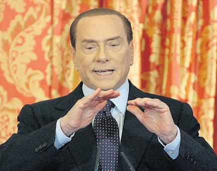 Silvio Berlusconi speaks during a news conference where he threatened to bring down the Italian government of Mario Monti
