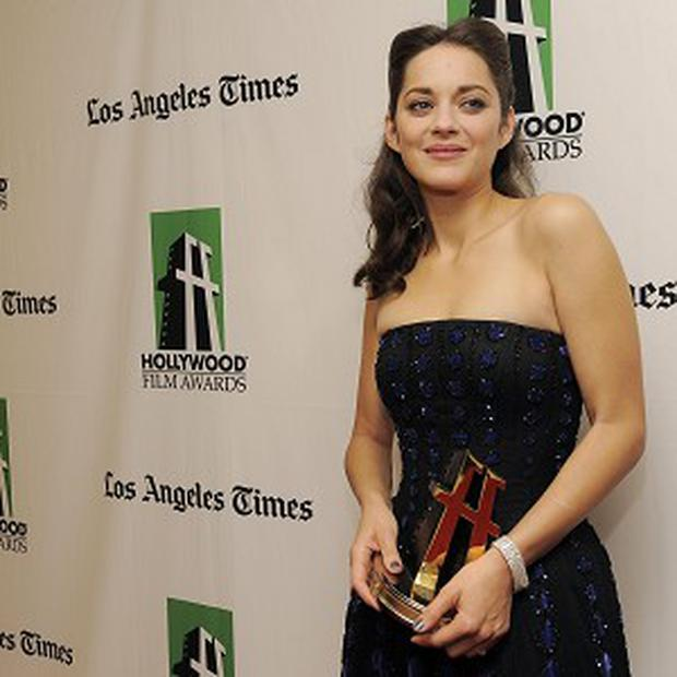 Marion Cotillard says she rarely tells love stories in her movies