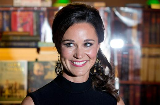 Pippa Middleton, sister of Catherine, Duchess of Cambridge, poses for photographers to promote her first book 'Celebrate', on the subject of party planning. Photo: Reuters