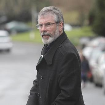 Gerry Adams should admit he was in the IRA, DUP leader Peter Robinson has demanded