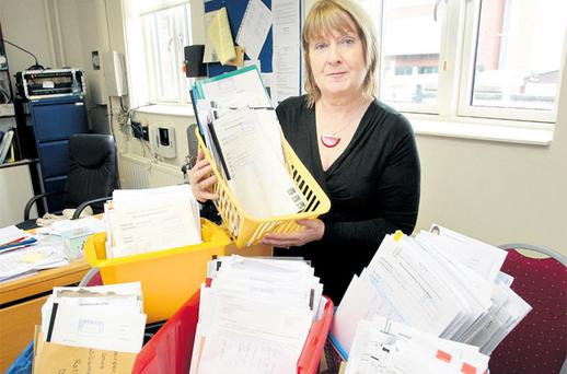 Miriam Mulkerrin, principal of St Louis Junior School in Rathmines, Dublin pictured with some of the many applications she received for a substitute teacher to cover maternity leave