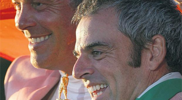 Darren Clarke and Paul McGinley celebrate with the Ryder Cup after Europe's victory at the K Club in 2007. Both are in the running for captaincy for 2014.