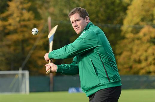 Ireland's new squad member Michael Bent tries his hand at hurling during the squad training session at Carton House yesterday