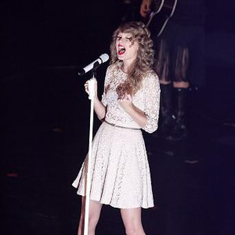 Taylor Swift will co-host the Grammy nominations show