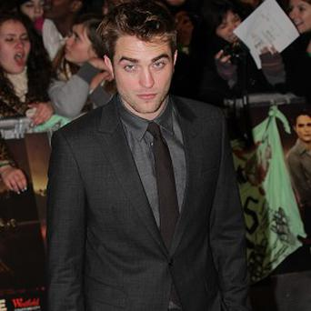 Robert Pattinson has promised fans a sweet ending to The Twilight Saga: Breaking Dawn - Part 2