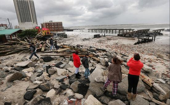 People view the area where a 2000-foot section of the uptown boardwalk was destroyed by flooding in Atlantic City. Photo: Getty Images