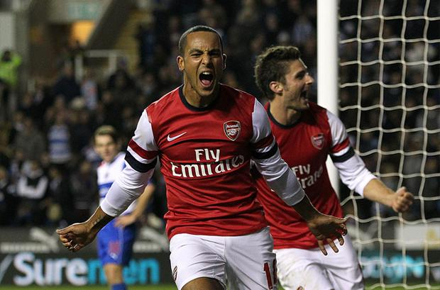 The Walcott celebrates scoring his side's sixth goal during the Capital One Cup, Fourth Round match at the Madejski Stadium, Reading. Photo: PA