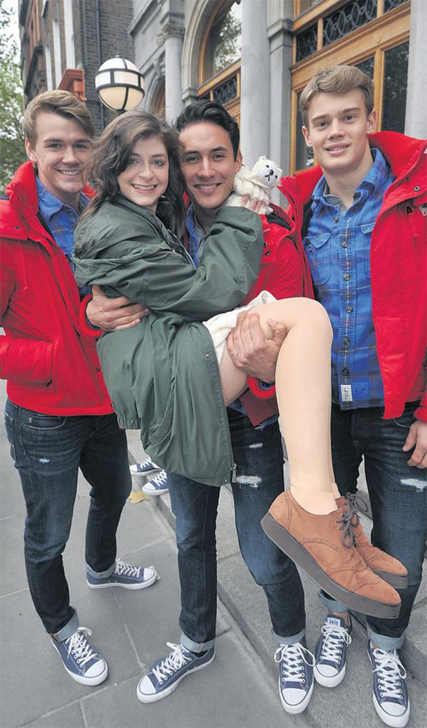Asha Bourne (16) from Glasnevin with Abercrombie and Fitch models Rhydian Wilson, Pierre Trintignant and Robert Johnston. Photo: DAMIEN EAGER