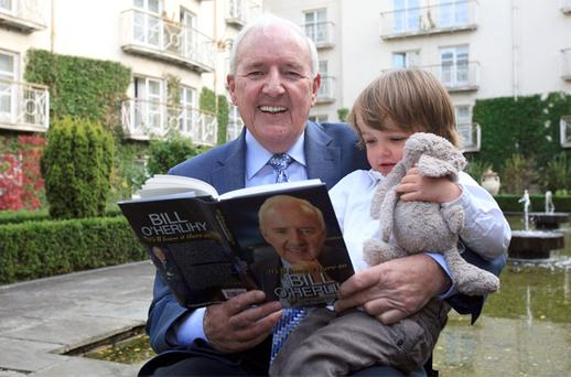 RTE's Bill O'Herlihy with his granddaughter Isla Conlan at his book launch. Photo: Collins