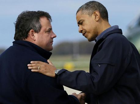 President Barack Obama is greeted by New Jersey Gov. Chris Christie. Photo: PA