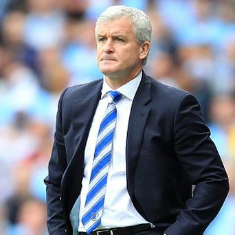 Mark Hughes, pictured, has been backed by Tony Fernandes on Twitter