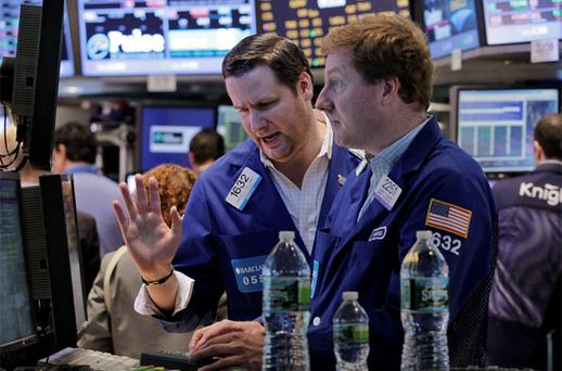 Traders work on the floor of the New York Stock Exchange following its reopening. Photo: Reuters