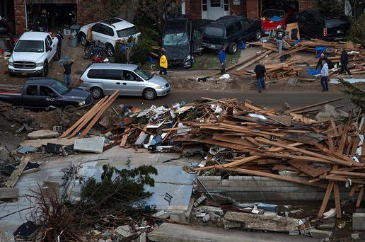 Residents return to their destroyed homes in Brighton, New York on October 31, 2012. New York City and the sodden U.S. Northeast began an arduous journey back to normal on Wednesday after mammoth storm Sandy killed at least 64 people in a rampage that swamped coastal cities and cut power to millions. REUTERS/Adrees Latif (UNITED STATES - Tags: ENVIRONMENT DISASTER)