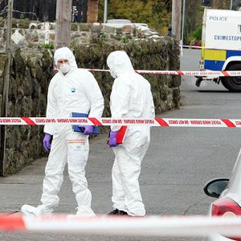Police forensic experts at the scene of the fatal shooting in the Longlands Road area of Newtownabbey, Co Antrim