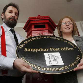 Sub-postmistress Penny Murphy, right, and her husband Richard Murphy with the commemorative plaque