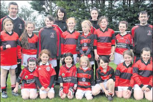 Newmarket's under-10 girls met up with Norita and Shauna Kelly during the football blitz which was held at Boherbue GAA grounds. Also included are trainers Aidan O'Sullivan and Mick Lynch.