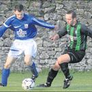 Fermoy's Alan Baragry keeps the ball in play and looks to get around Mayfield United's Dave Kiely during the first half of last Sunday morning's league clash between the sides.