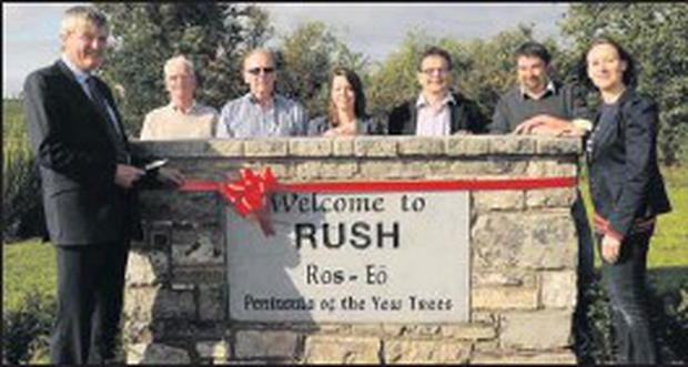 Brendan Ryan TD, Matt Henry, Majella MacHugh, Pascal Hosford, Willie Browne, Peter Smullen and Deirdre McMenamin at the unveiling of the new sign by Rush Tidy Towns.