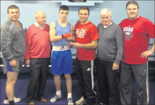 Members of Bracken Boxing Club make a presentation to Christopher O'Reilly shortly before his departure to Russia with the Ireland schoolboys squad.