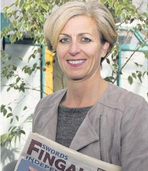 Siobhan Moore with a copy of the Fingal Independent.