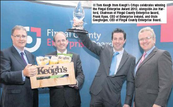 Tom Keogh from Keogh's Crisps celebrates winning the Fingal Enterprise Award 2012, alongside Joe Harford, Chairman of Fingal County Enterprise Board, Frank Ryan, CEO of Enterprise Ireland, and Oisin Geoghegan, CEO of Fingal County Enterprise Board.