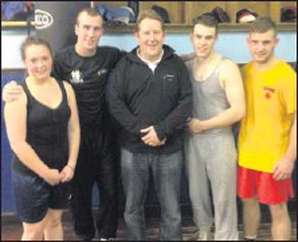 Senator Darragh O'Brien pictured last week during a visit to Bracken Boxing Club, with (l to r) Chloe Gray, Shane Egan, Conor Duffy and Gerard Whitehouse who will be fighting in their home town on Friday next.