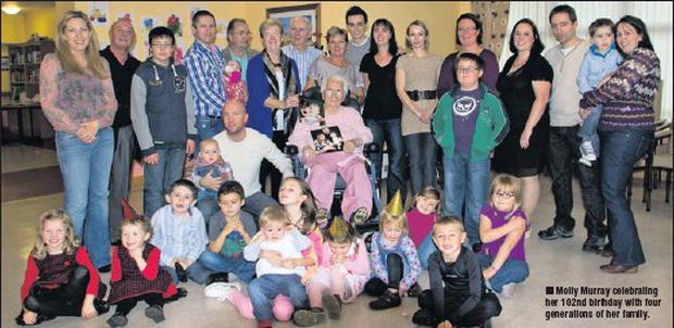 Molly Murray celebrating her 102nd birthday with four generations of her family.