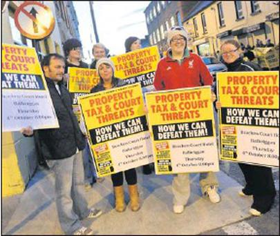 Members of the public at a protest against the household charge which took place as Minister James Reilly was in Balbriggan to open the Fumbally Exchange.