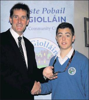 Pictured here with his medal, Karl is congratulated by Principal of Ardgillan CC. Mr. Michael O'Leary.