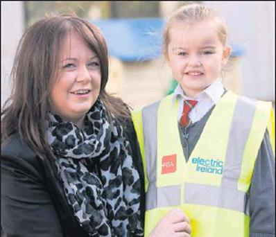 Matilda Tighe with her aunt Emma Tighe, who presented the high visibility vests to the school on behalf of Electric Ireland.