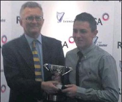 James King is presented with the Division 2 Wicketkeeping award at the Leinster Cricket Union prize-giving.