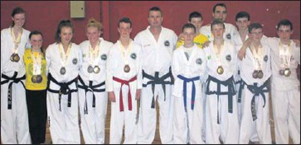 World Cup medal winners from the River Valley Academy Taekwon-Do Club.