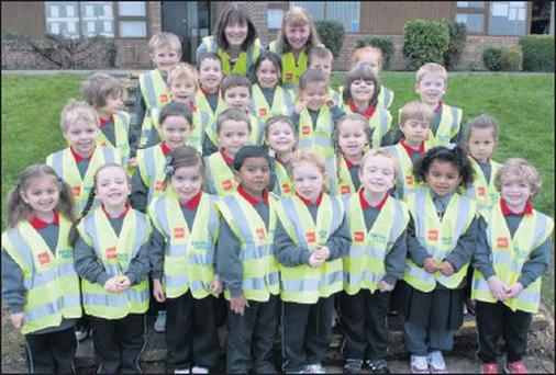 Junior infants from Holy Family JNS in Swords proudly displaying their RSA/Electric Ireland high-visibily vests along with Noeleen Daniels from Electric Ireland and the youngsters' teacher, Ms. O'Brien.