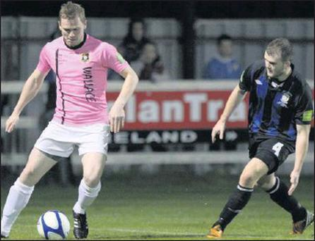Tom Elmes shields the ball during Wexford Youths' last home clash of the season with Athlone Town on Friday last. They won 4-2 with goals from Danny Furlong (two), Joey Mulcahy and Eric Molloy to remain fourth.