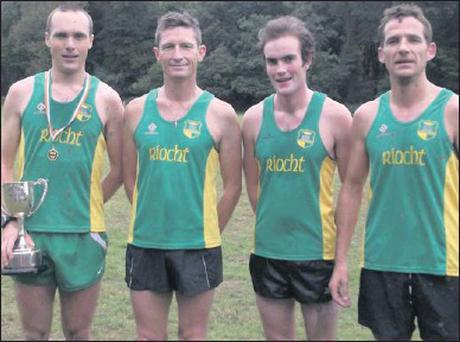 The men's winning Novice team from An Ríocht Athletic Club who took part in the Cross-country Championships in Killarney at the weekend, from left, Darren Burke, who won the Freddie Murphy Perpetual Cup as winner of the 6,000m event, Chris Grayson,...