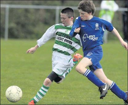 ■ Listowel Celtic's Micheál Kirby and Killarney Athletic's Seán O'Neill in a serious chase for control of this ball during their Under-14 Division 2 game at Tanavalla on Saturday. Photo by John Reidy