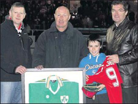 Former Rovers and Ireland striker, Paul McGee, presents an international jersey and cap to Sligo Rovers Chairman, Dr. Dermot Kelly, at the Showgrounds last Saturday. Also included are Anthony Kilfeather (left) and Paul's son, Andrew.