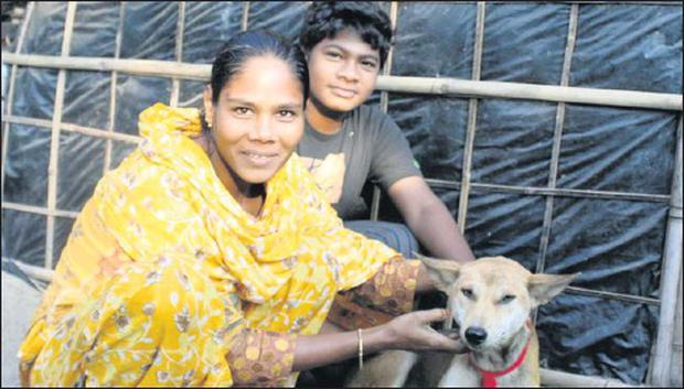 People in Bangladesh with dogs. Pic: WSPA