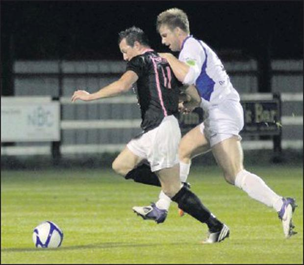 Aidan Keenan (Wexford Youths) is pursued by Keith Cowen (Finn Harps) in Friday's Division 1 encounter.