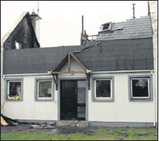 The house at Ardamine which was badly damaged by fire.