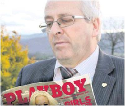 Mattie McGrath TD reading a fascinating piece about An Taoiseach Enda Kenny in an internationally-renowned magazine.