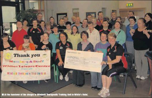 At the handover of the cheque to Windmill Therapeutic Training Unit in White's Hotel.