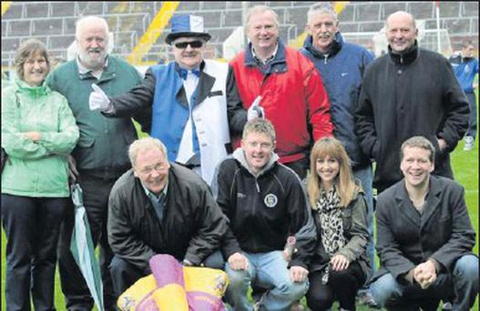 Family members and friends of Eoin Quigley with a staunch Sarsfields supporter at the Cork county final on Sunday week last.