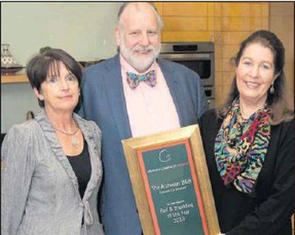 Eileen and Chris Hadlington of The Arches B&B in Rosslare receiving their award from Georgina Campbell.