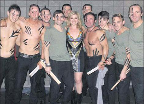 Members of Extreme Rhythm with pop superstar Kelly Clarkson at the show in the Wembly Arena.