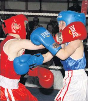 Cathal Doyle (Na Fianna, Wexford) exchange punches with Mikey Connors (St. Mary's, New Ross) during their Boy 2 29 kg. bout in Sacre Coeur on Saturday last which Connors won on a majority decision.