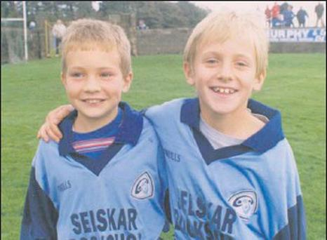 FROM BOYS TO MEN: This photograph from our archives shows Aidan Rochford and Liam Og McGovern as young mascots for the St. Anne's team which beat Starlights to clinch the Co. Senior football championship title of 2000 in New Ross. On Sunday next the...