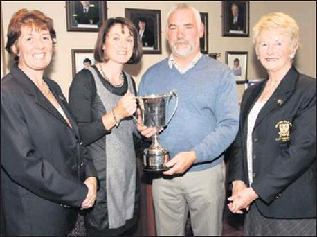 Lily Rowe, winner of the J.J. Devereux Matchplay Cup in Wexford for the third year in a row, receives her prize from Nicky Lacey on behalf of the sponsors as Osnat Manning (lady Captain) and Maureen Rossitter (lady President) look on.
